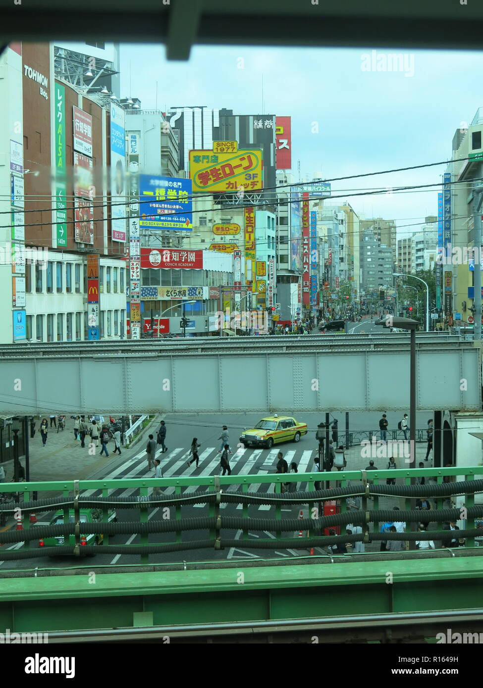 A view of central Tokyo from the window of a train on the Yamanote Line (JR East), Tokyo to Meguro: high density of buildings and railtracks; Japan - Stock Image