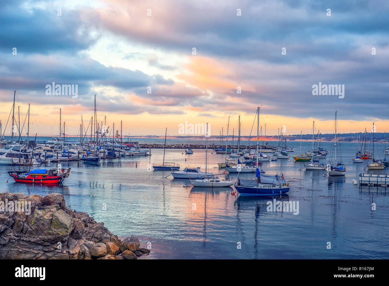 Monterey, California, USA. Boats moored in Monterey Bay photographed at sunset. - Stock Image