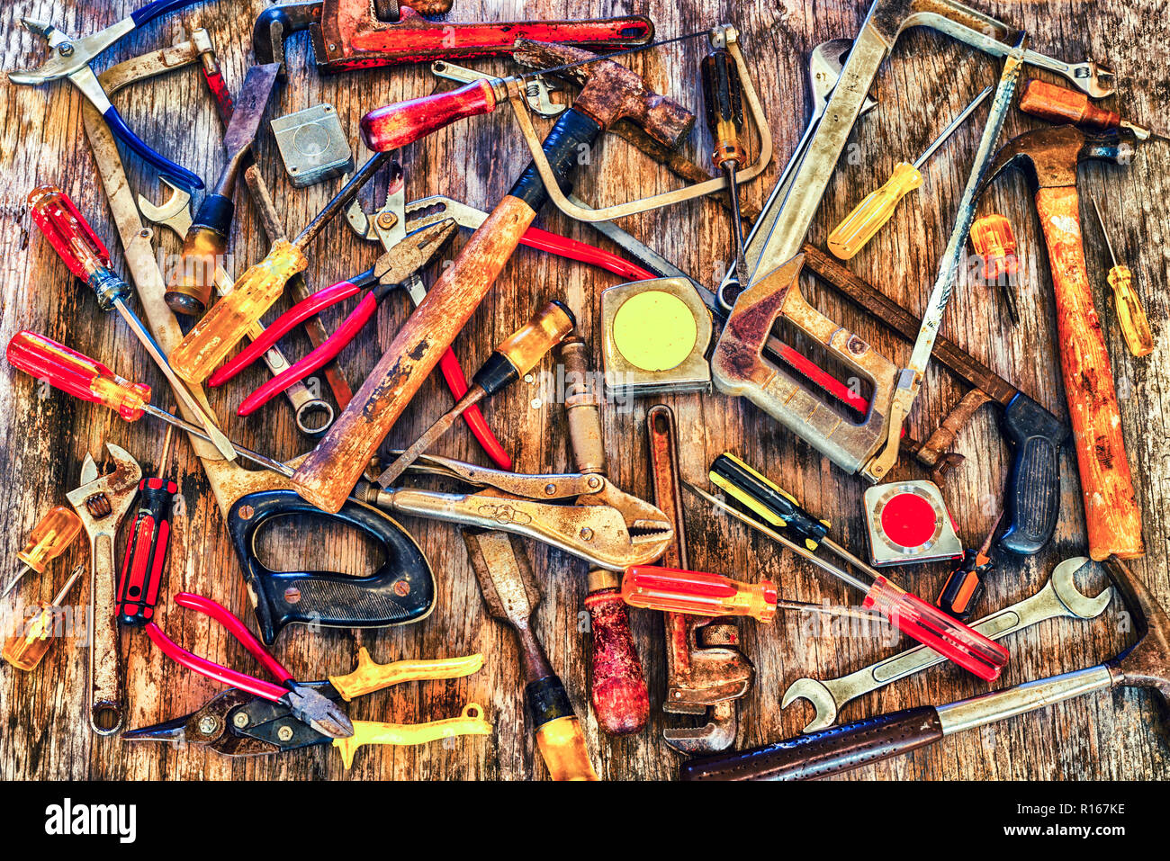 Close up of a group of tools on a wooden background. Stock Photo