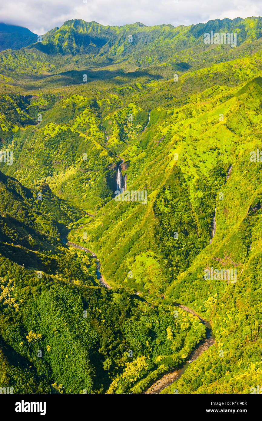 Aerial of a waterfall in the interior of Kauai, Hawaii, USA - Stock Image
