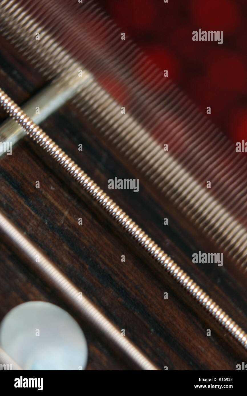Steel strings vibrating on guitar, close-up - Stock Image
