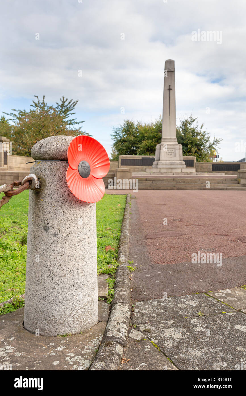 Warrington Cenotaph 2018 displays a number of large plastic poppies to remember the Fallen Heroes Soldiers - Lest We Forget Stock Photo