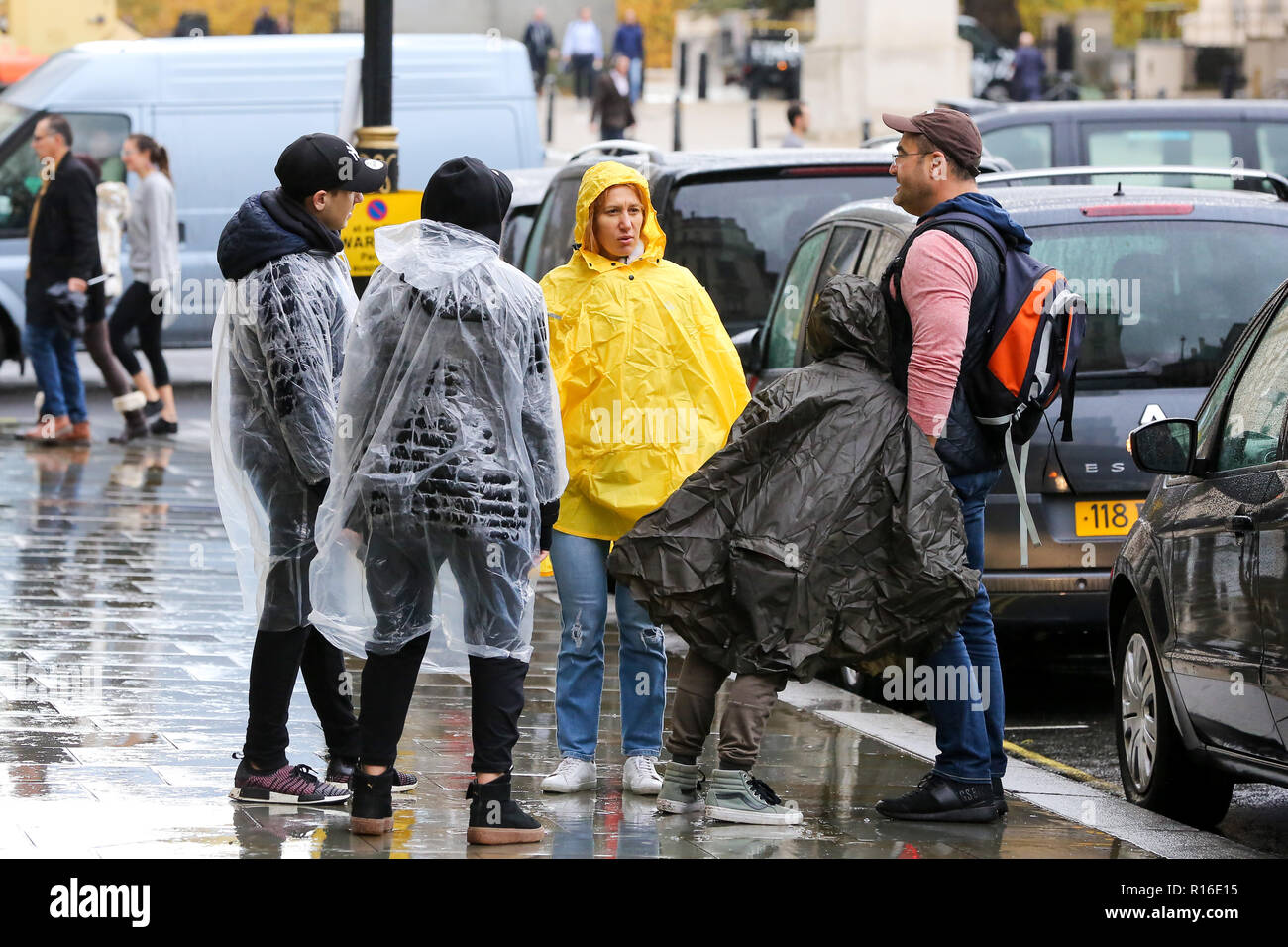 Westminster, London, UK 9 Nov 2018 - Tourists with ponchos on a wet but mild day in capital. According to The Met Office, windy with heavy rain is forecast for the evening in London.   Credit: Dinendra Haria/Alamy Live News - Stock Image