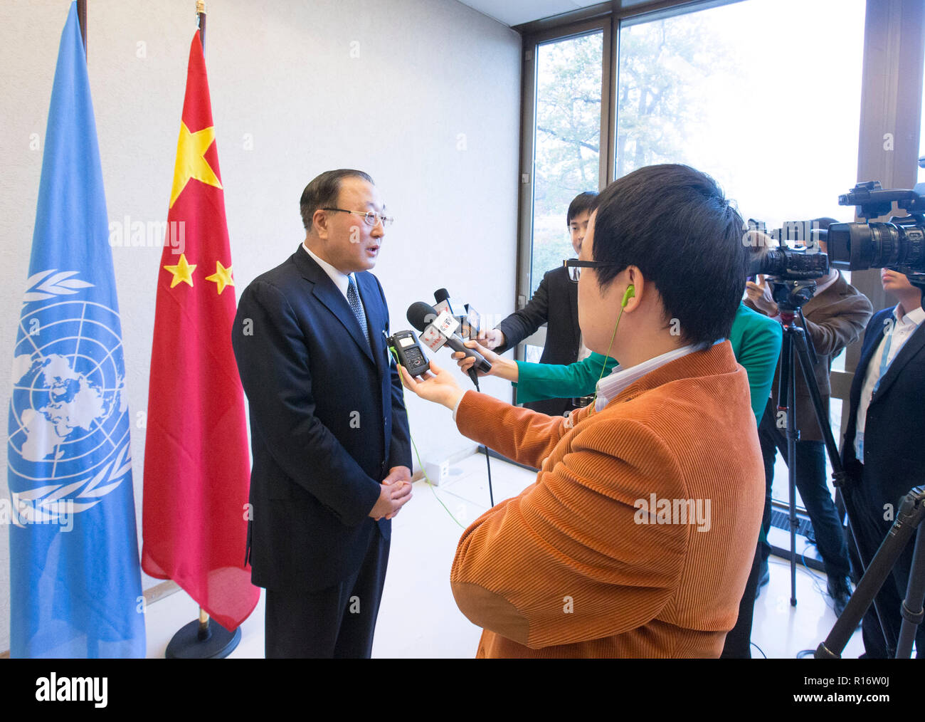 Geneva, Switzerland. 9th Nov, 2018. Zhang Jun (L), deputy head of the Chinese government delegation and China's assistant foreign minister, speaks to reporters in Geneva, Switzerland, on Nov. 9, 2018. China has made real progress in the field of human rights promotion and the human rights development path with Chinese characteristics is completely correct, Zhang said here on Friday. Credit: Xu Jinquan/Xinhua/Alamy Live News - Stock Image