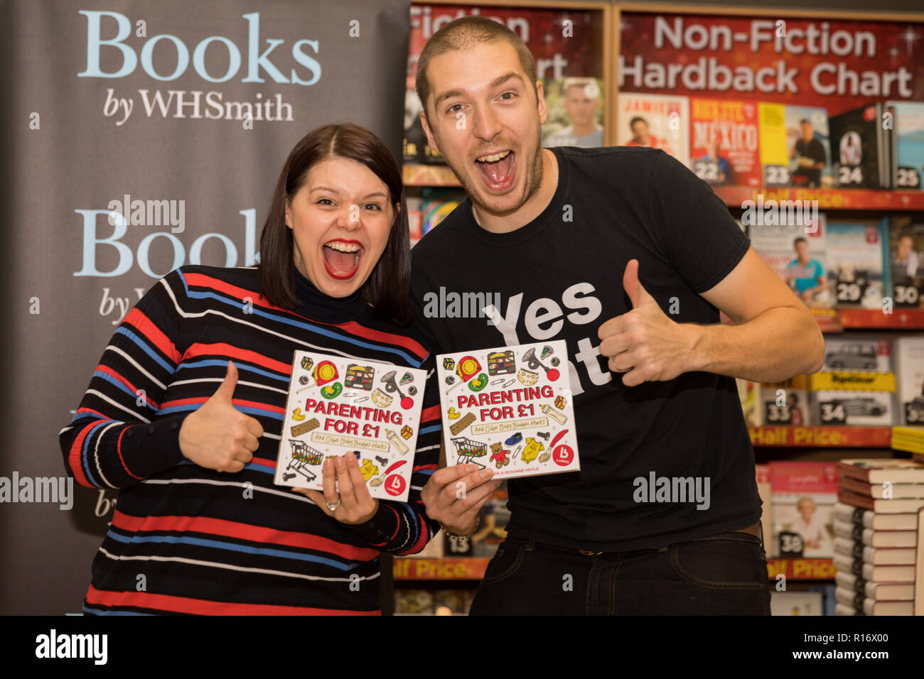 YouTube sensation LadBaby signs his first book 'Parenting for £1 and Other Baby Budget Hacks' in WHSmiths, Westfield, London.  Celebrity Dad of the year 2018 winner, Mark Hoyle and his wife, Roxanne, sign their book for a queue of fans and followers of their parenting blog 'LadBaby' Credit: amanda rose/Alamy Live News - Stock Image