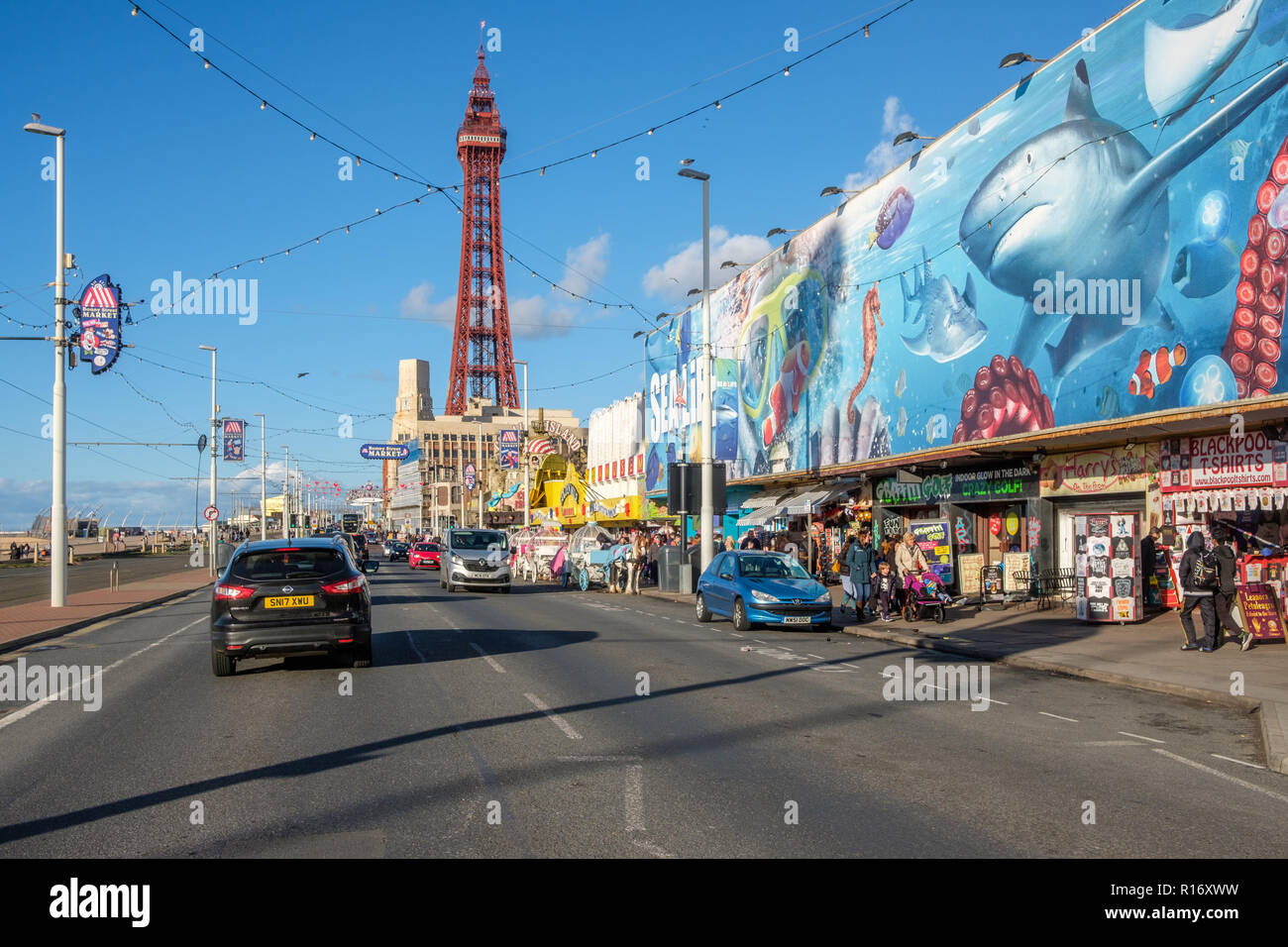 Blackpool promenade during an autumn weekend. Blackpool is one of Englands favorite seaside resorts. Stock Photo