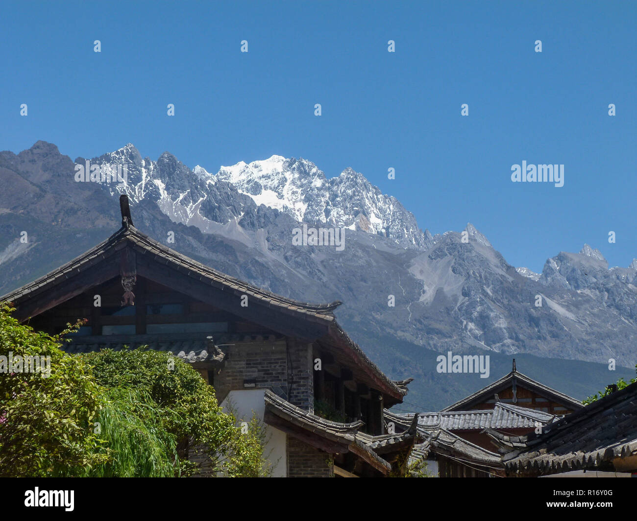 Snow covered Jade Dragon Mountains situated in the Yunnan Province of China. - Stock Image