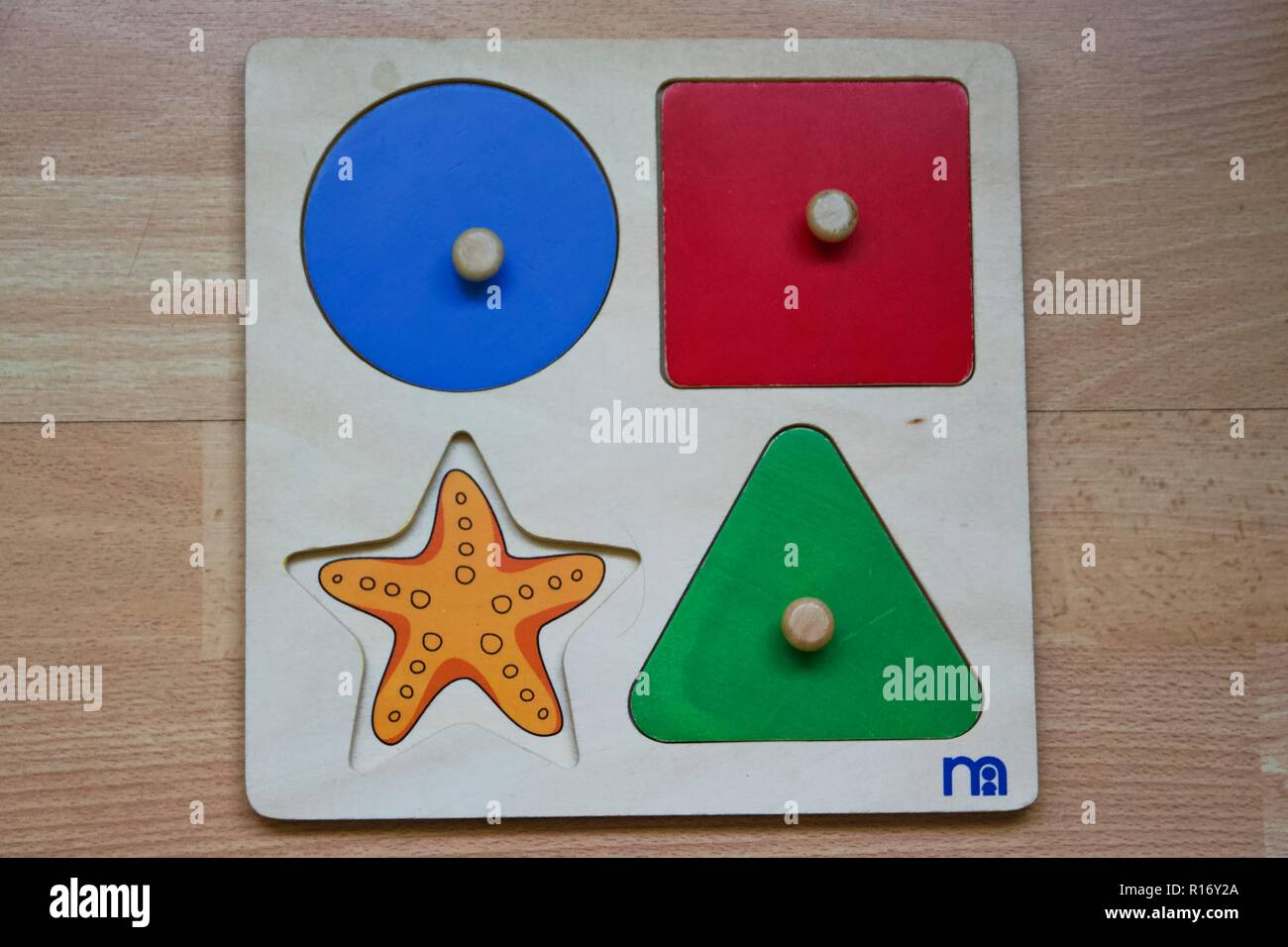 A Mothercare wooden puzzle toy with one missing piece / missing part - Stock Image