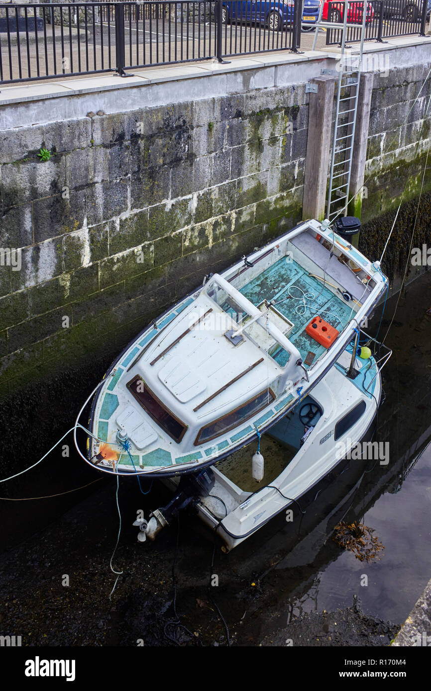 Two boats one on top of each other in Castletown Harbour Stock Photo
