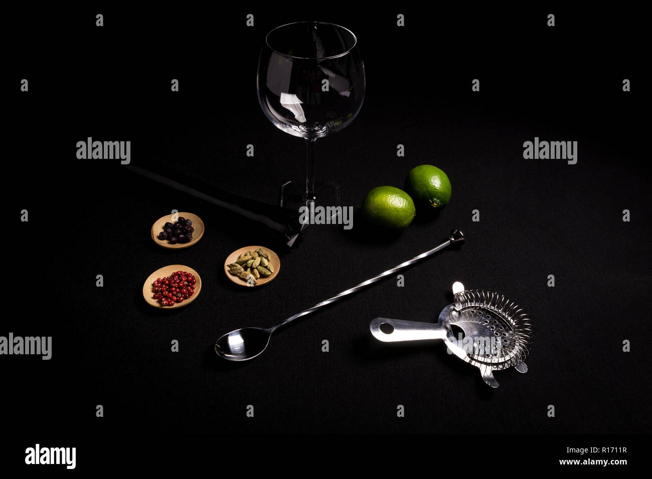 tasty and fresh gin and tonic cocktail on a black background next to your ingredients Stock Photo
