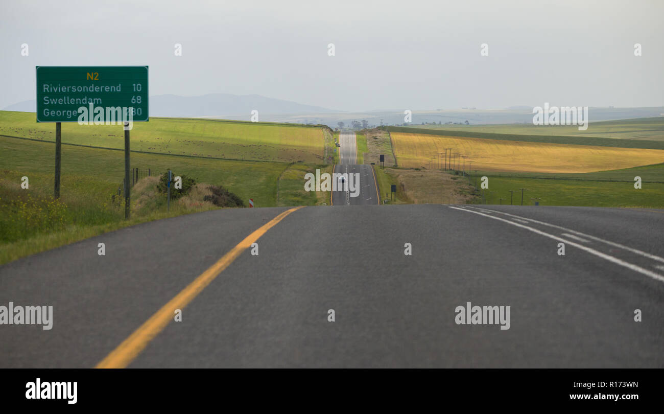 tarred national road from Cape Town to George on the Garden Route with green signboard with distances in kilometres, South Africa Stock Photo