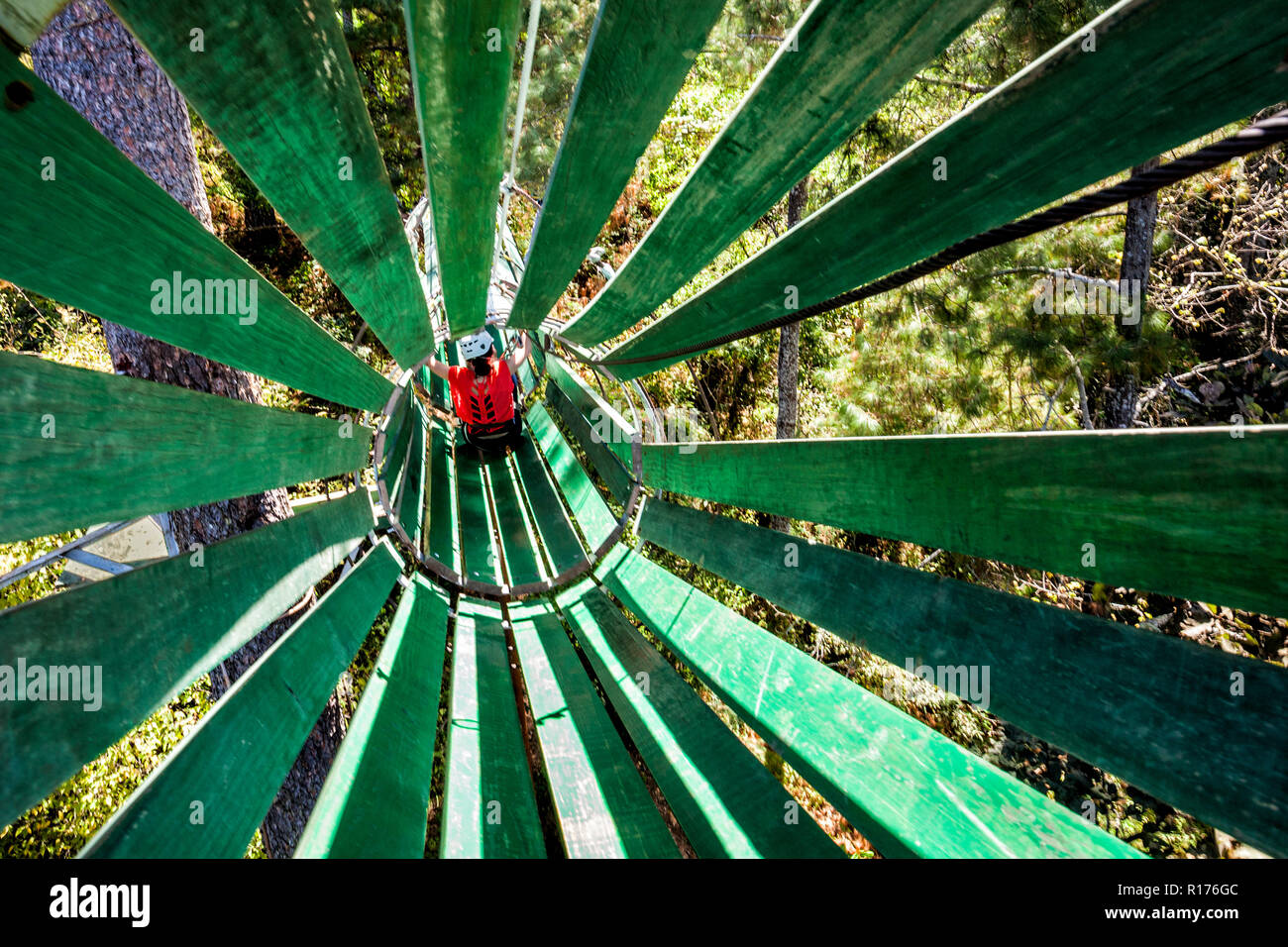 Wooden tunnel on the hanging bridge at Zirahuen Forest and Resort, Michoacan, Mexico. - Stock Image