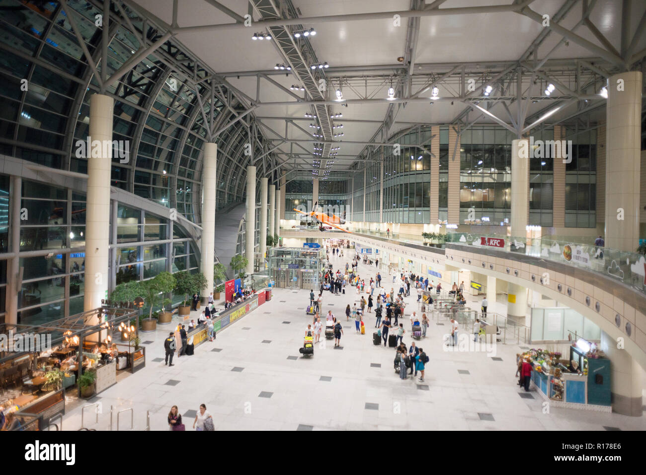 Moscow, Domodedovo, Russia - July 8, 2018: Hall of Domodedovo International Airport in Moscow with Passengers Inside. Night Time. Orange Airplane - Stock Image