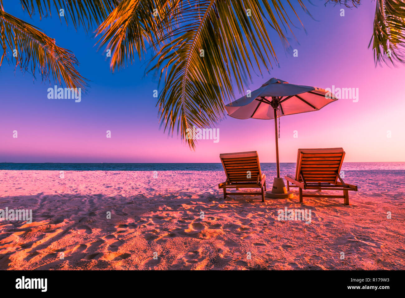 Perfect Sunset Beach Two Sun Chairs With Umbrella Under