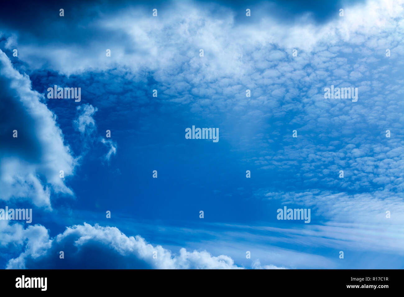 Blue sky with clouds background - Stock Image