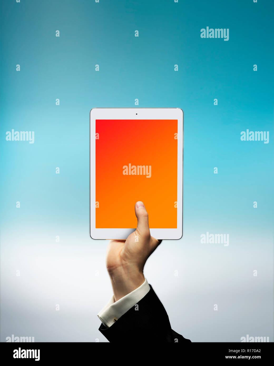 Businessman's hand holding digital tablet above cloud, cloud storage - Stock Image