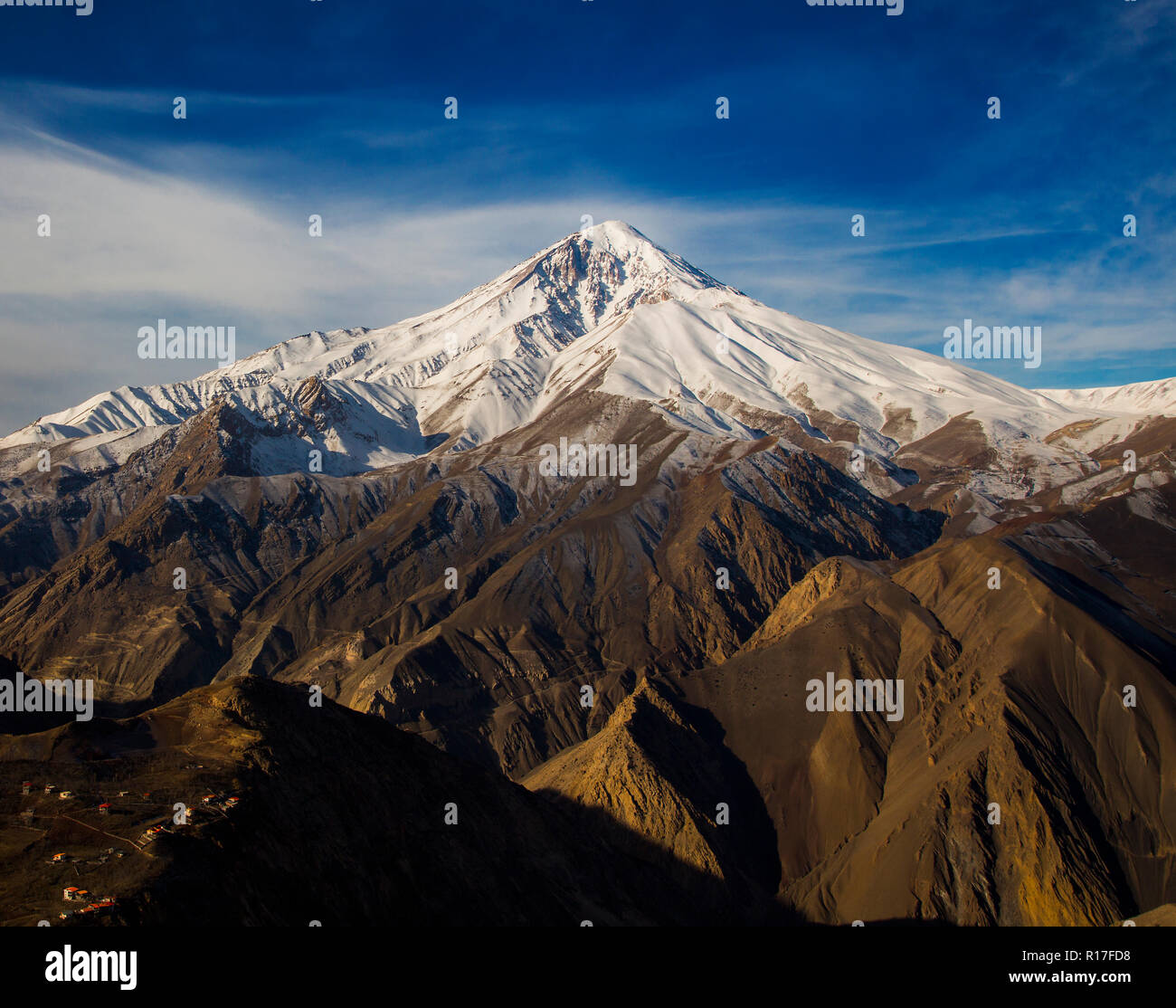 Mount Damavand, a potentially active volcano, is a stratovolcano which is the highest peak in Iran and the highest volcano in Asia. - Stock Image
