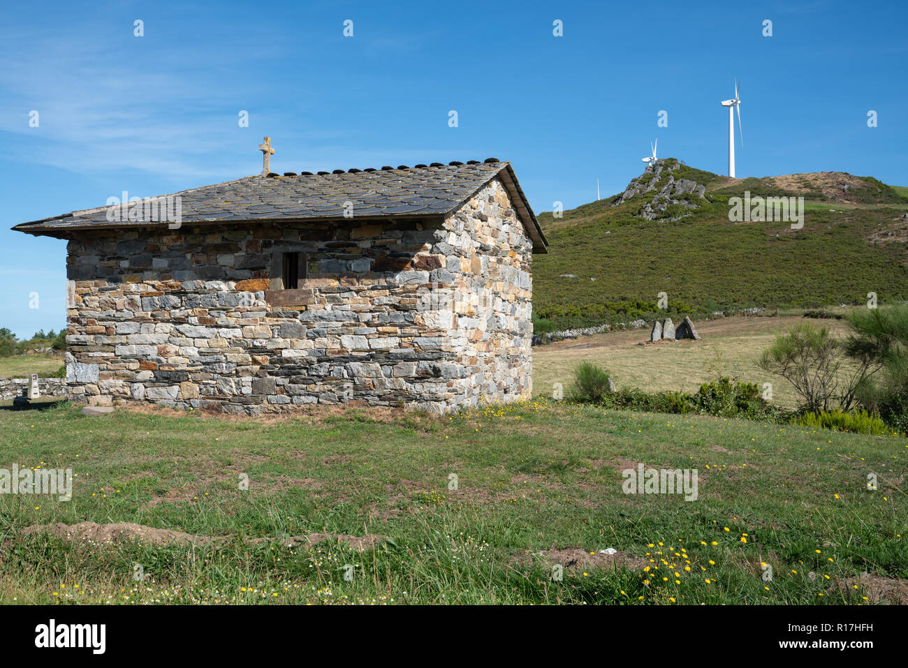 MOUNT MONTOUTO, SPAIN - AUGUST 26, 2018: Old chapel an pilgrim hospital on Mount Montouto, Camino de Santiago trail between Fonsagrada and O Cadavo on - Stock Image