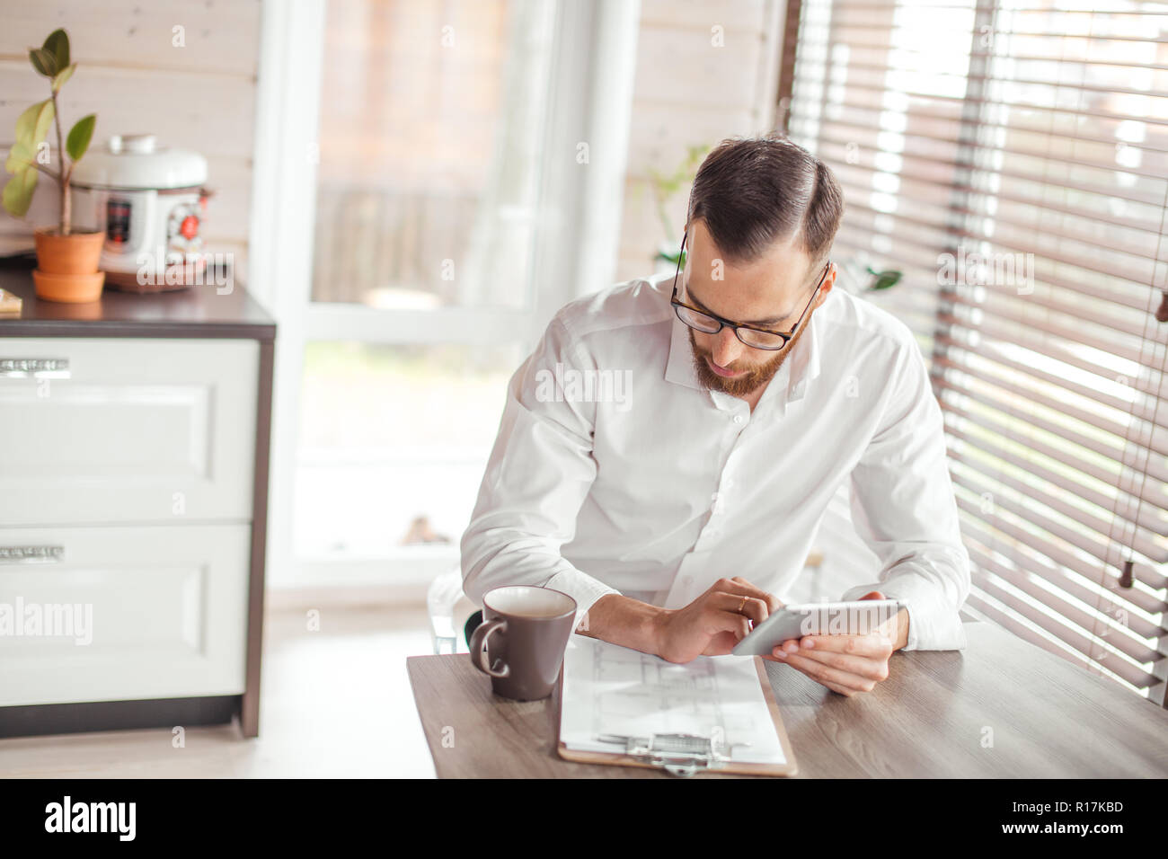 Serious applicant sitting in boardroom, preparing for interview with employer. - Stock Image