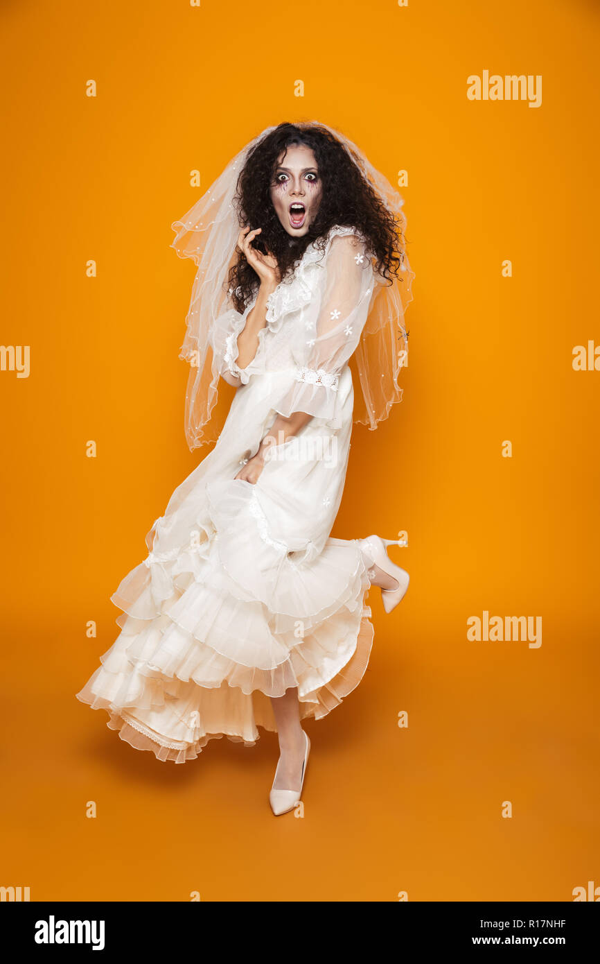 Full Length Shot Of Frightened Creepy Woman Zombie In White Wedding