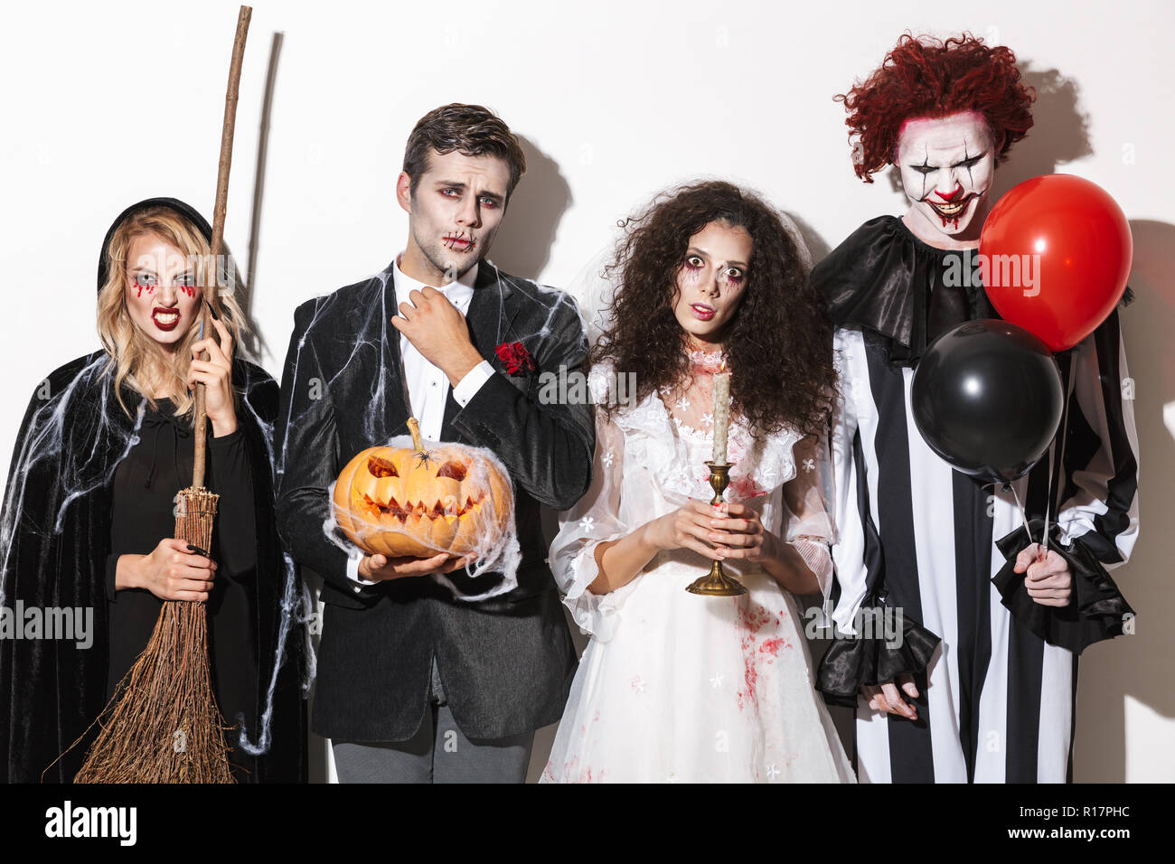 Halloween Group Costumes Scary.Group Of Friends Dressed In Scary Costumes Celebrating