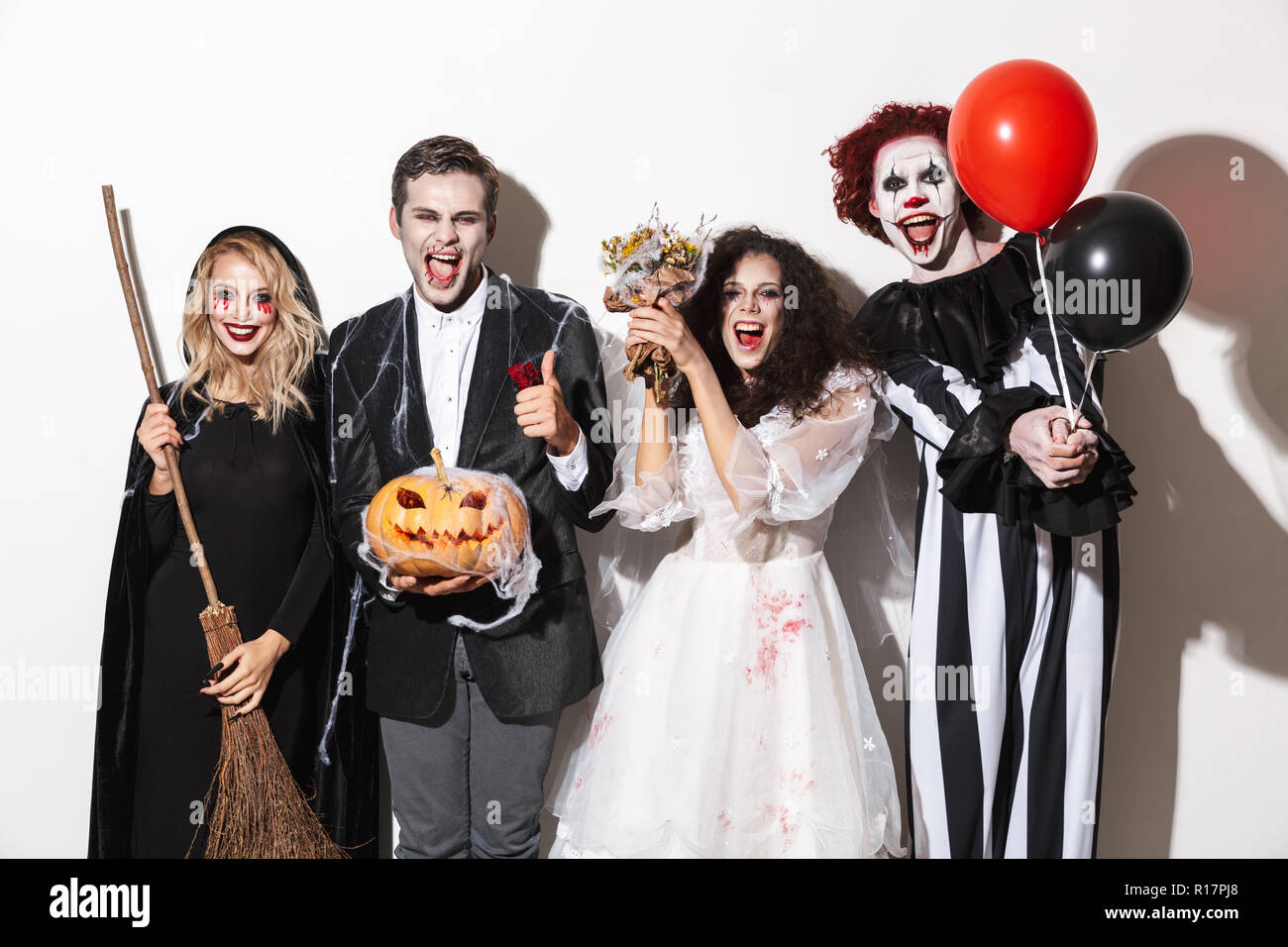 Halloween Group Costumes Scary.Group Of Joyful Friends Dressed In Scary Costumes