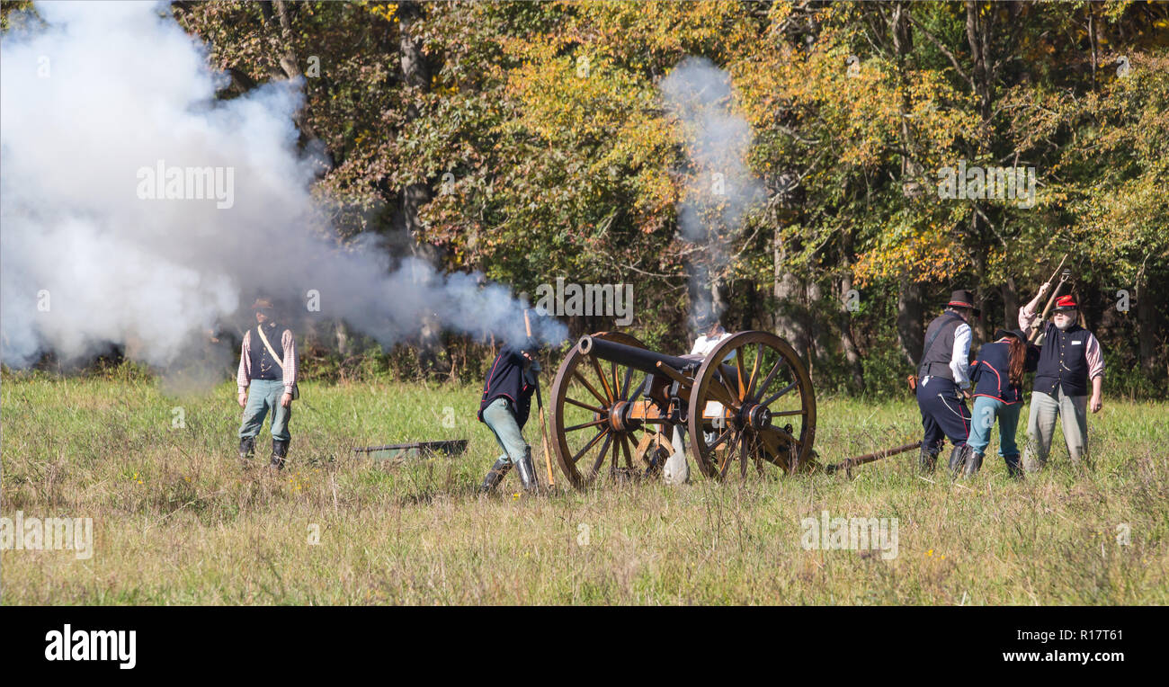 MCCONNELLS, SC (USA) - November 3, 2018: A cannon fires during a Civil War battle reenactment at Historic Brattonsville, a living history museum. - Stock Image