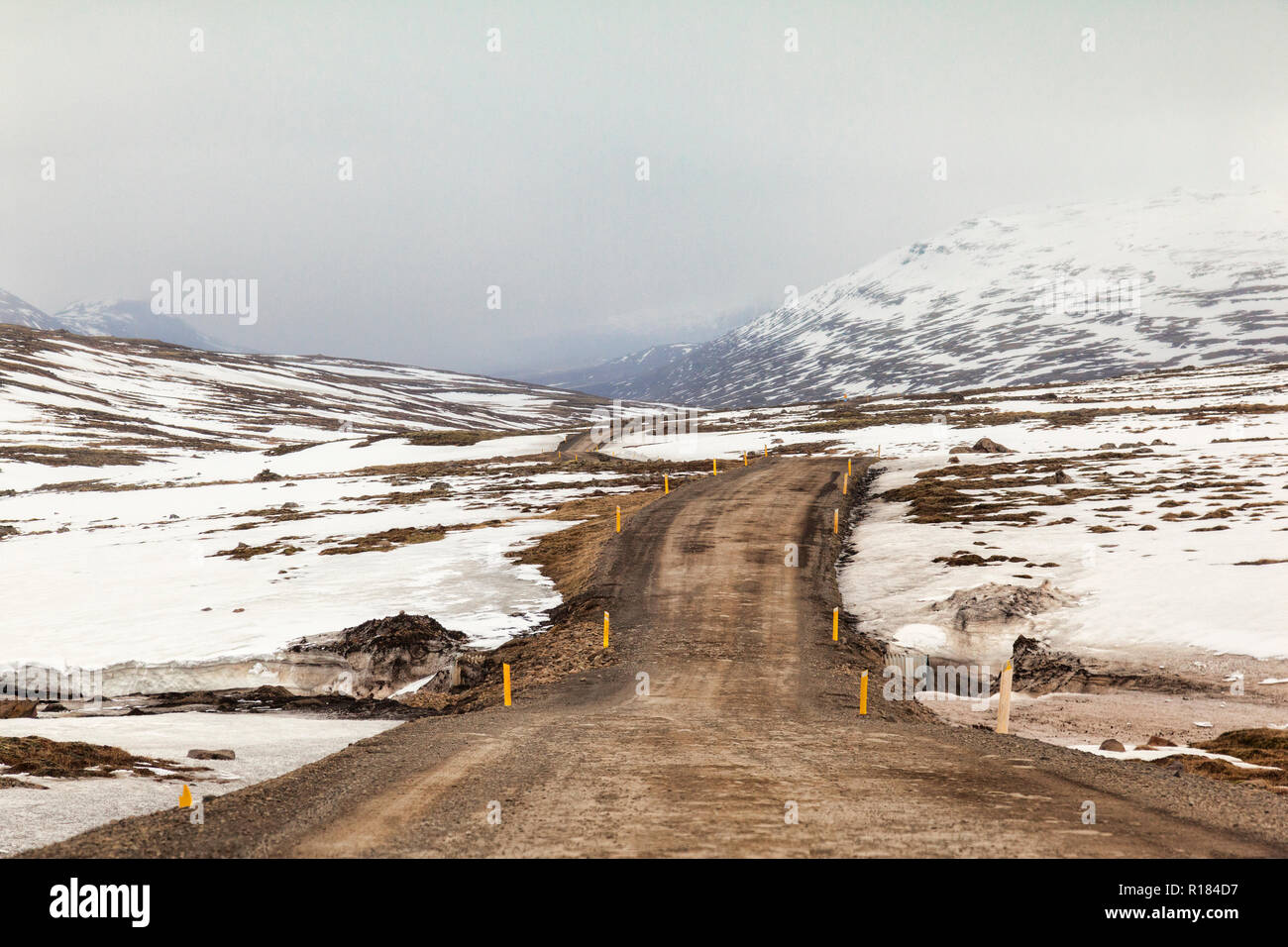 A high level mountain pass through snowy mountains in East Iceland. - Stock Image
