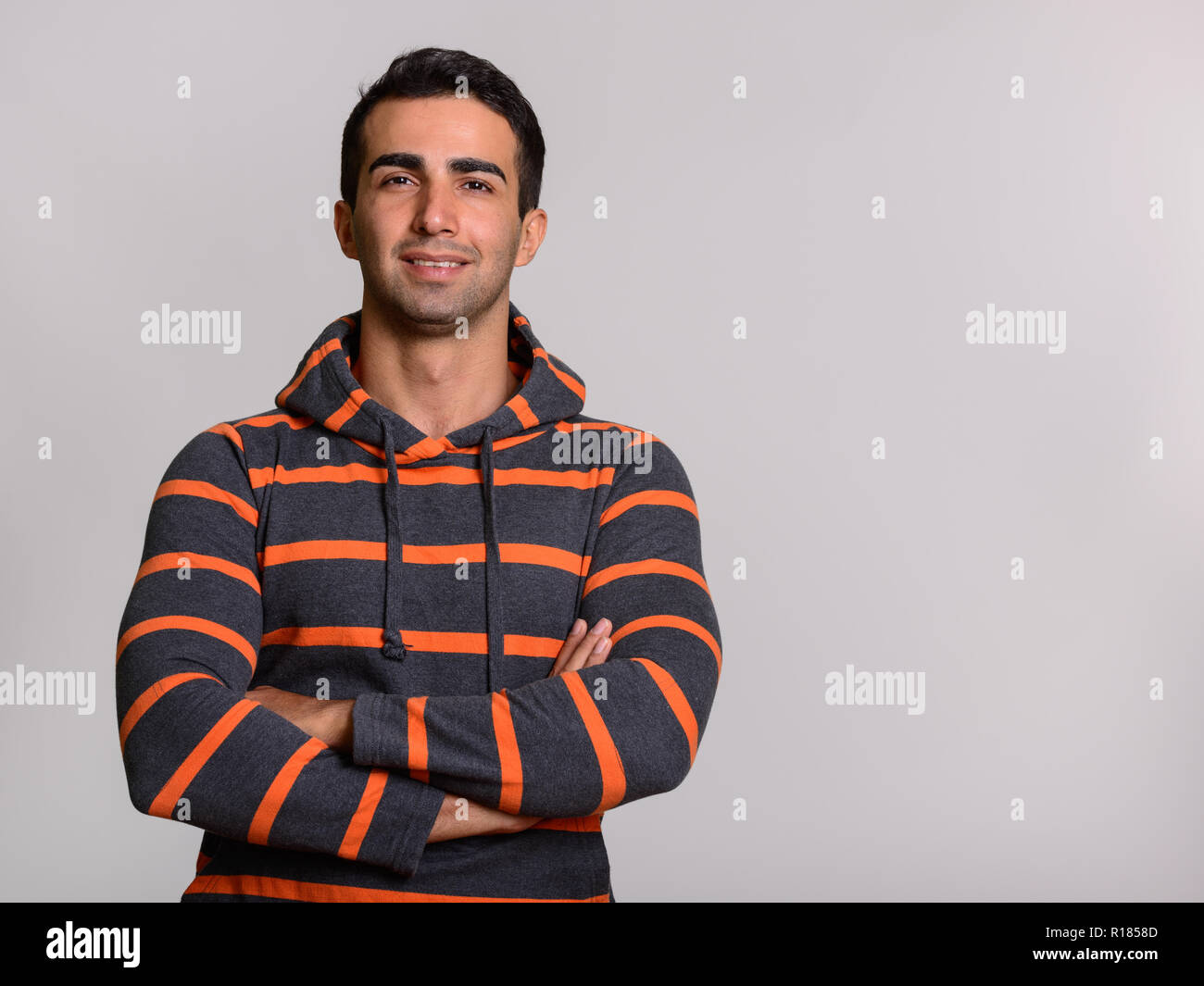 4ca6b635 Portrait of young handsome Persian man wearing hoodie Stock Photo ...