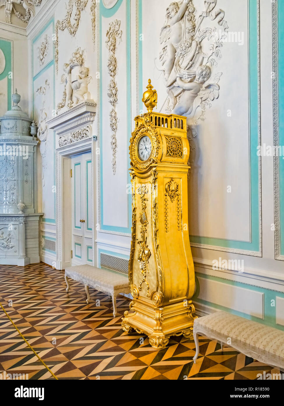 18 September 2018: St Petersburg, Russia - Gilded clock in the Peterhof Grand Palace. Stock Photo