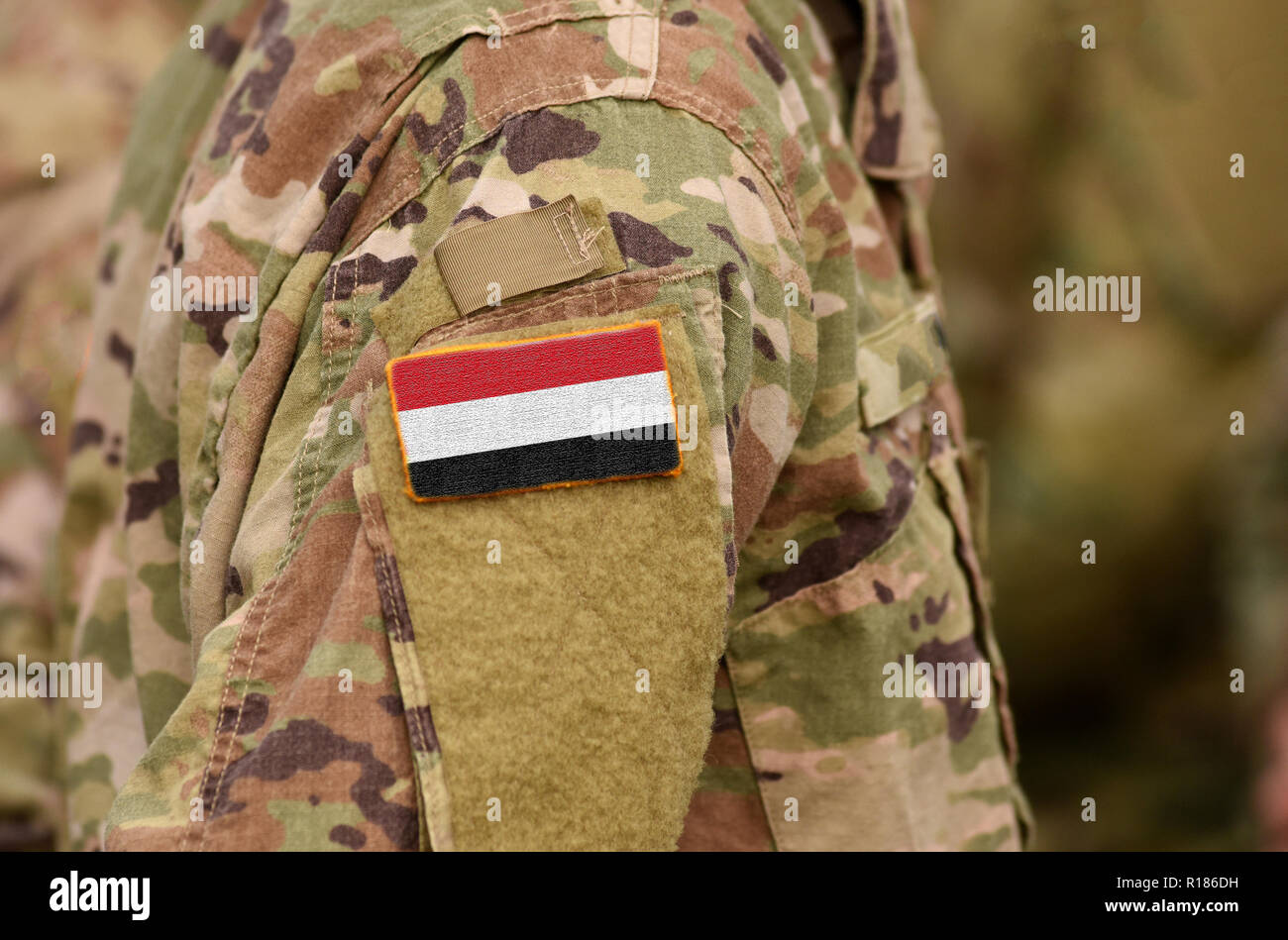 Yemen flag on soldiers arm. Republic of Yemen troops (collage) Stock Photo
