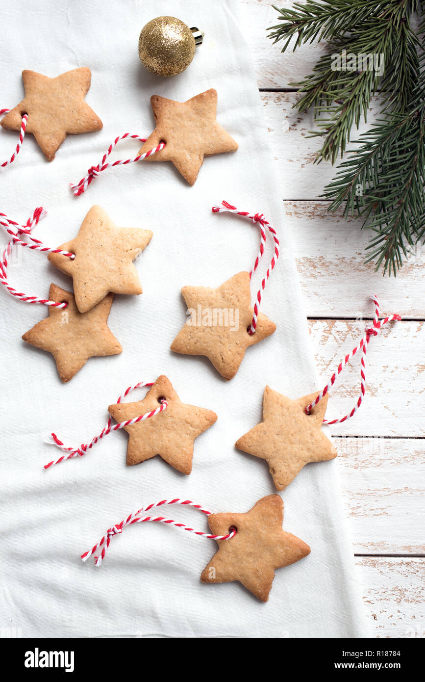 Christmas Star Shaped Gingerbread Cookies With Red Ropes For