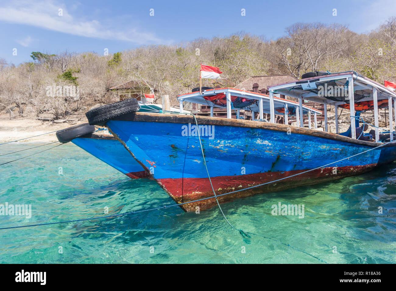 Traditional wooden boats at the beach of Menjangan Island, Indonesia - Stock Image