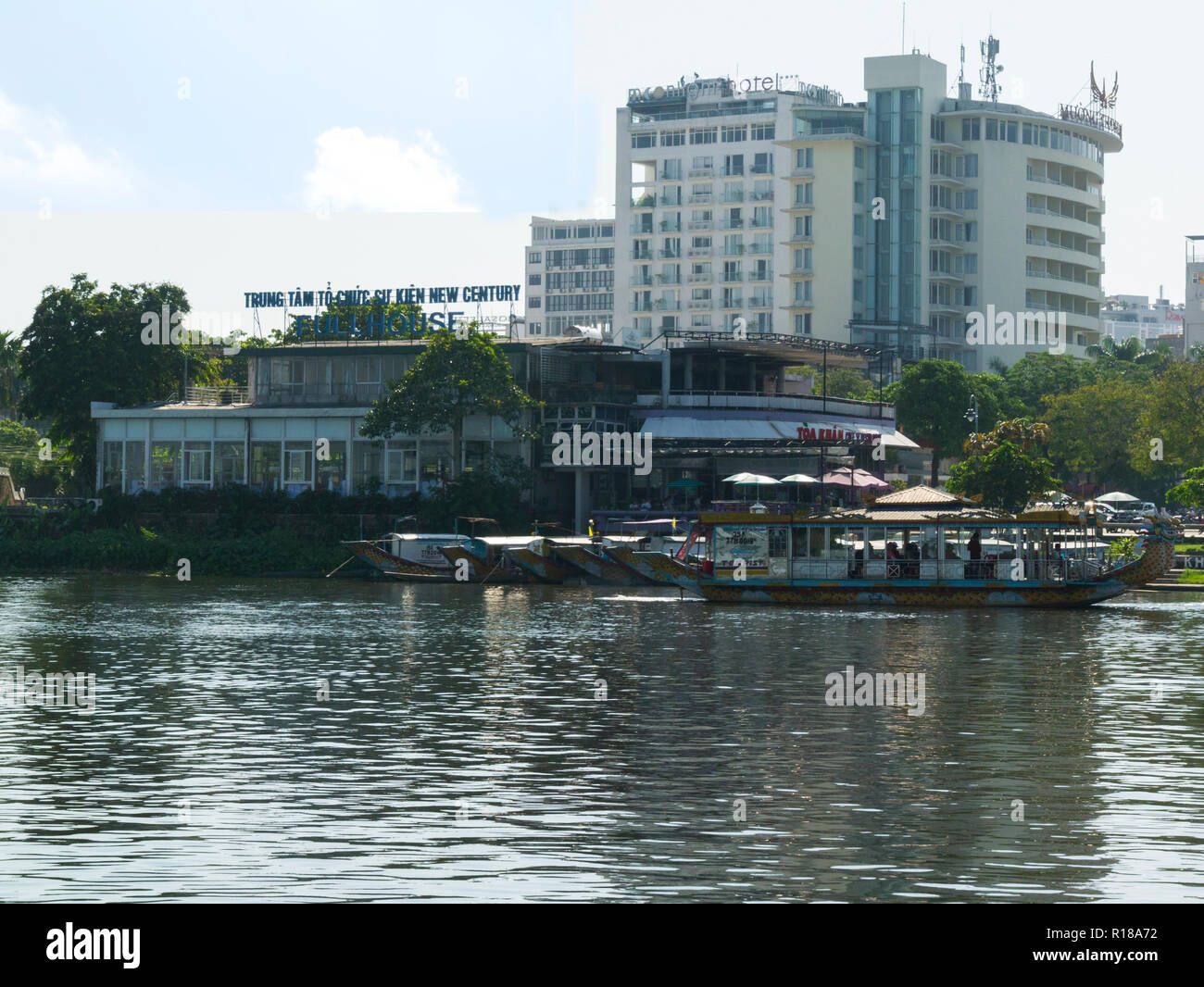 Looking back at Dragon boat pier Toa Kham boat dock from boat on Song Huong Perfume River Hue City former Royal Capital Vietnam Asia UNESCO World Heri - Stock Image