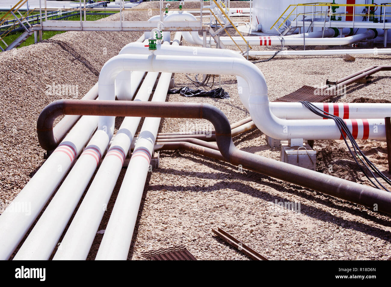 Steel fuel pipes and valves at the oil refinery - Stock Image