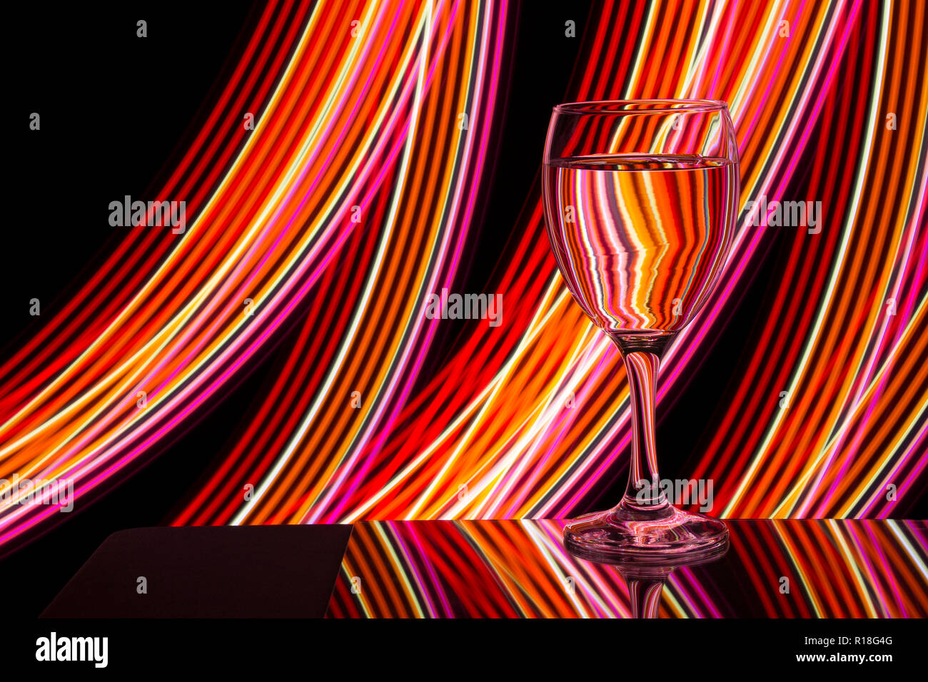 Wine glass / glasses on a black background with neon light painting Stock Photo