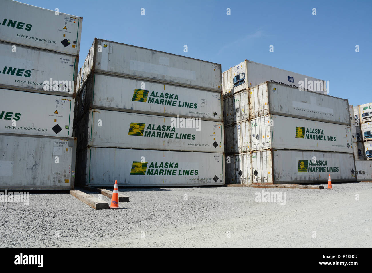 A stack of empty seafood shipping containers at a depot in the commercial fishing hub of Dutch Harbor, Unalaska Island, Alaska, United States. Stock Photo