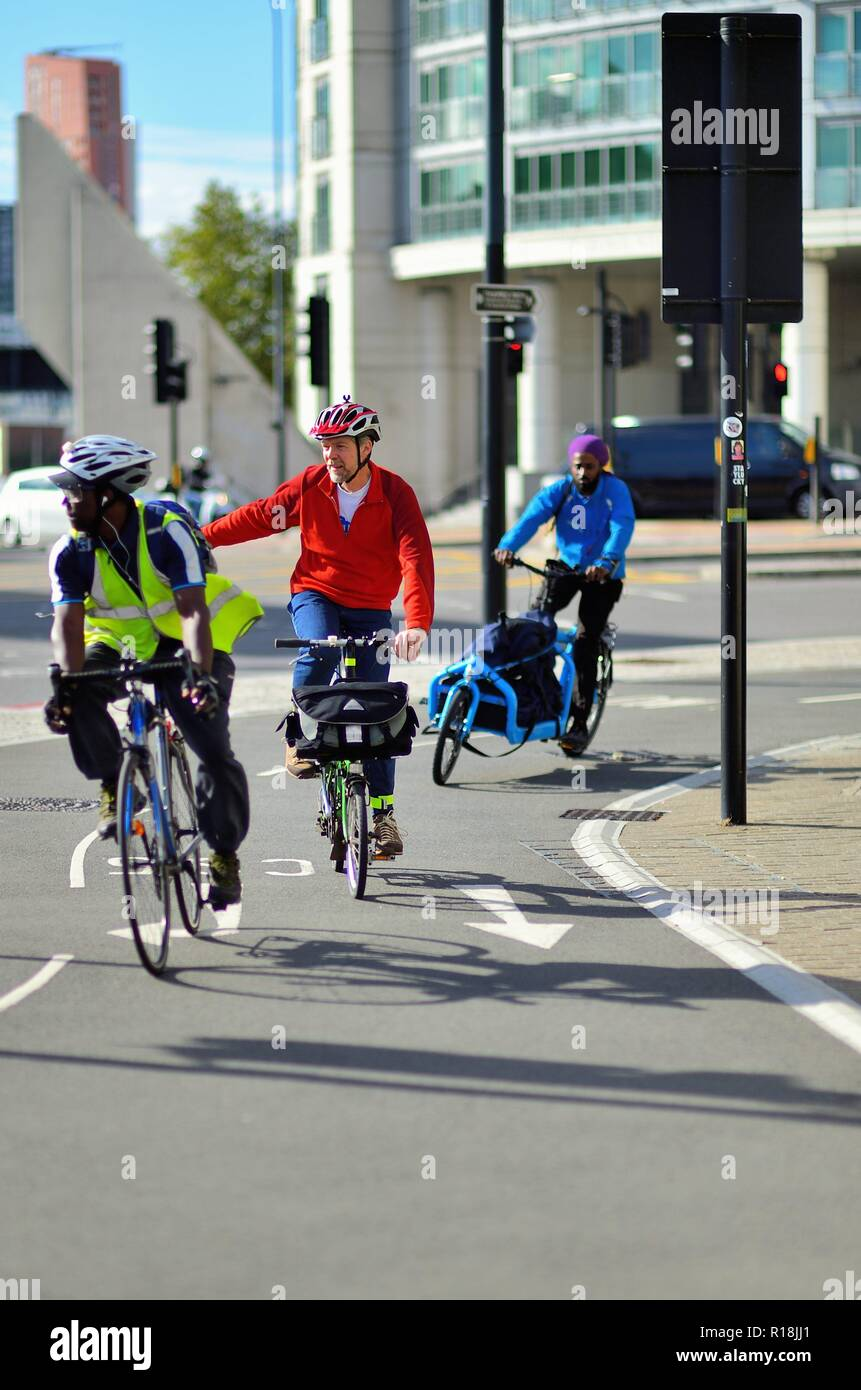 London, England, United Kingdom. cycle Riders create their own brand of traffic in a bicycle lane in the Lonodn borough of Lambeth. - Stock Image