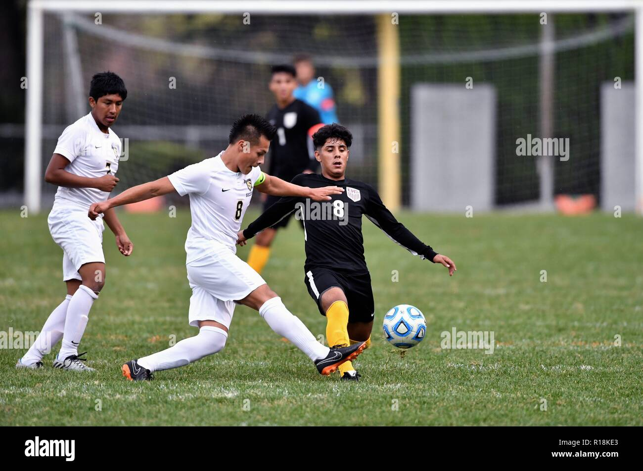Players battling for possession of the ball. USA. - Stock Image