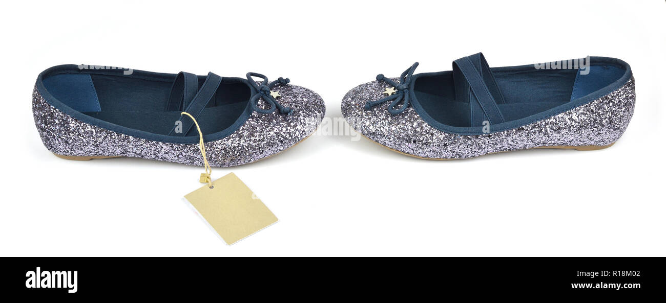 Shimmer silver blue ballerina flat shoes with crossed elastic drawstrings and a price tag on white - Stock Image