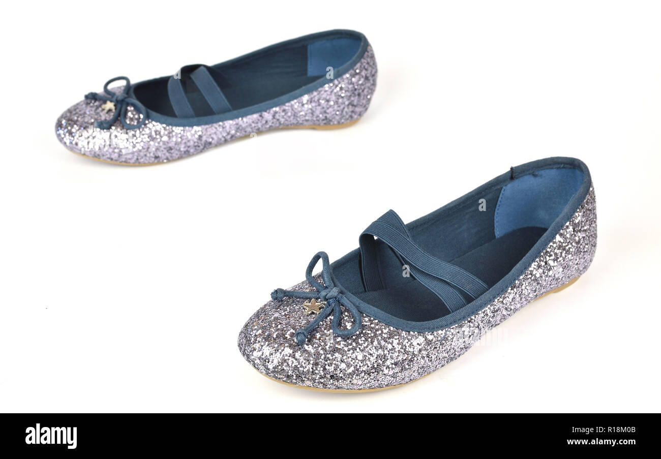 Comfy shimmer silver blue ballerina flats with crossed elastic drawstrings and soft cotton lining - on white background - Stock Image