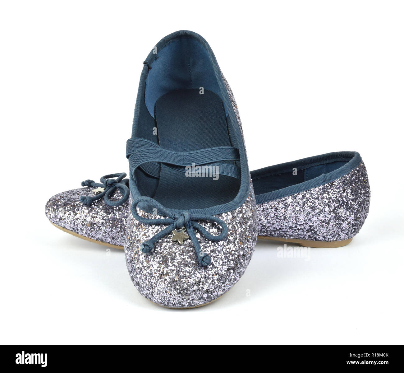 Shimmer silver blue ballerina flat shoes with crossed elastic drawstrings on white background - Stock Image