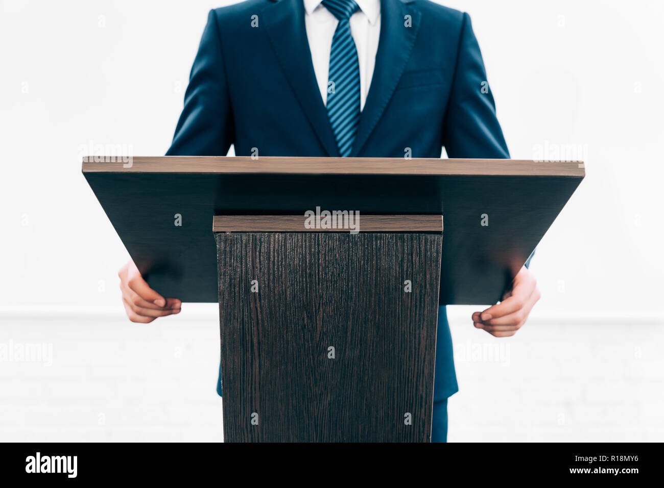 cropped image of lecturer standing at podium tribune during seminar in conference hall - Stock Image