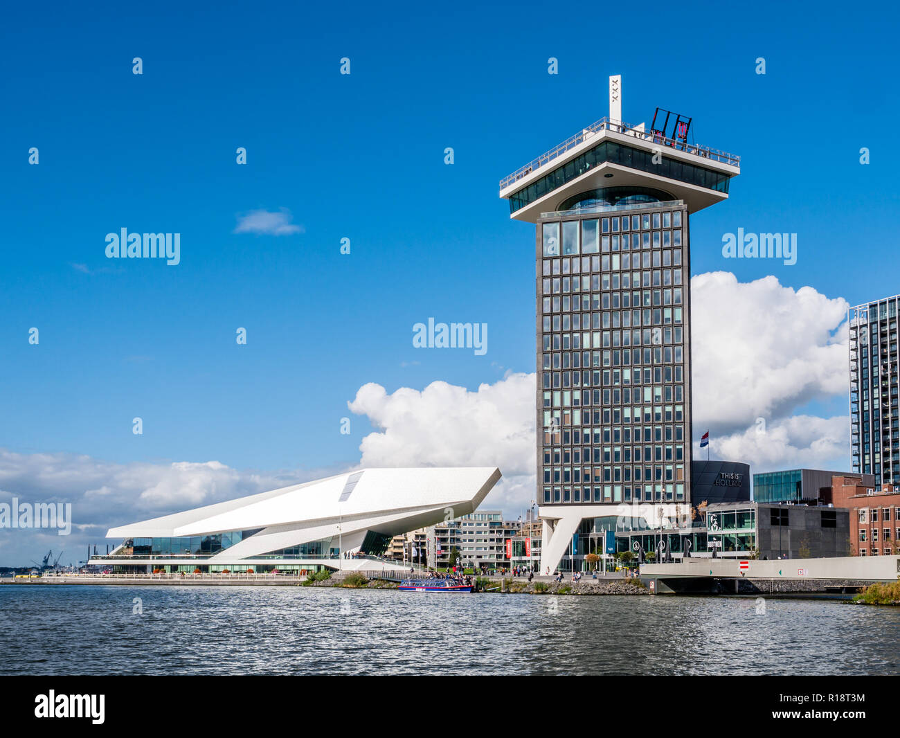 Adam Tower and Eye Filmmuseum from River IJ in Amsterdam, Netherlands - Stock Image