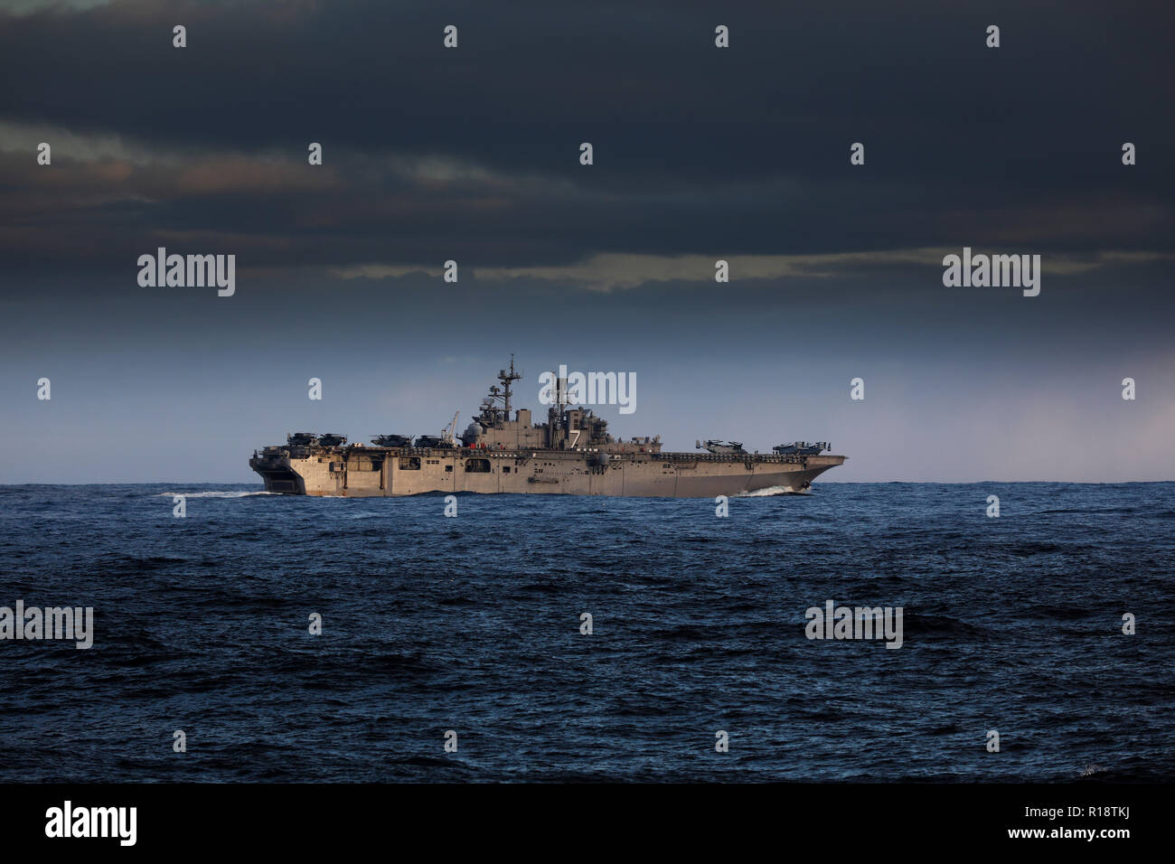 USS Iwo Jima assault carrier of the US Navy with tilt rotor V22 Osprey US Marine Corps aircraft embarked - Stock Image