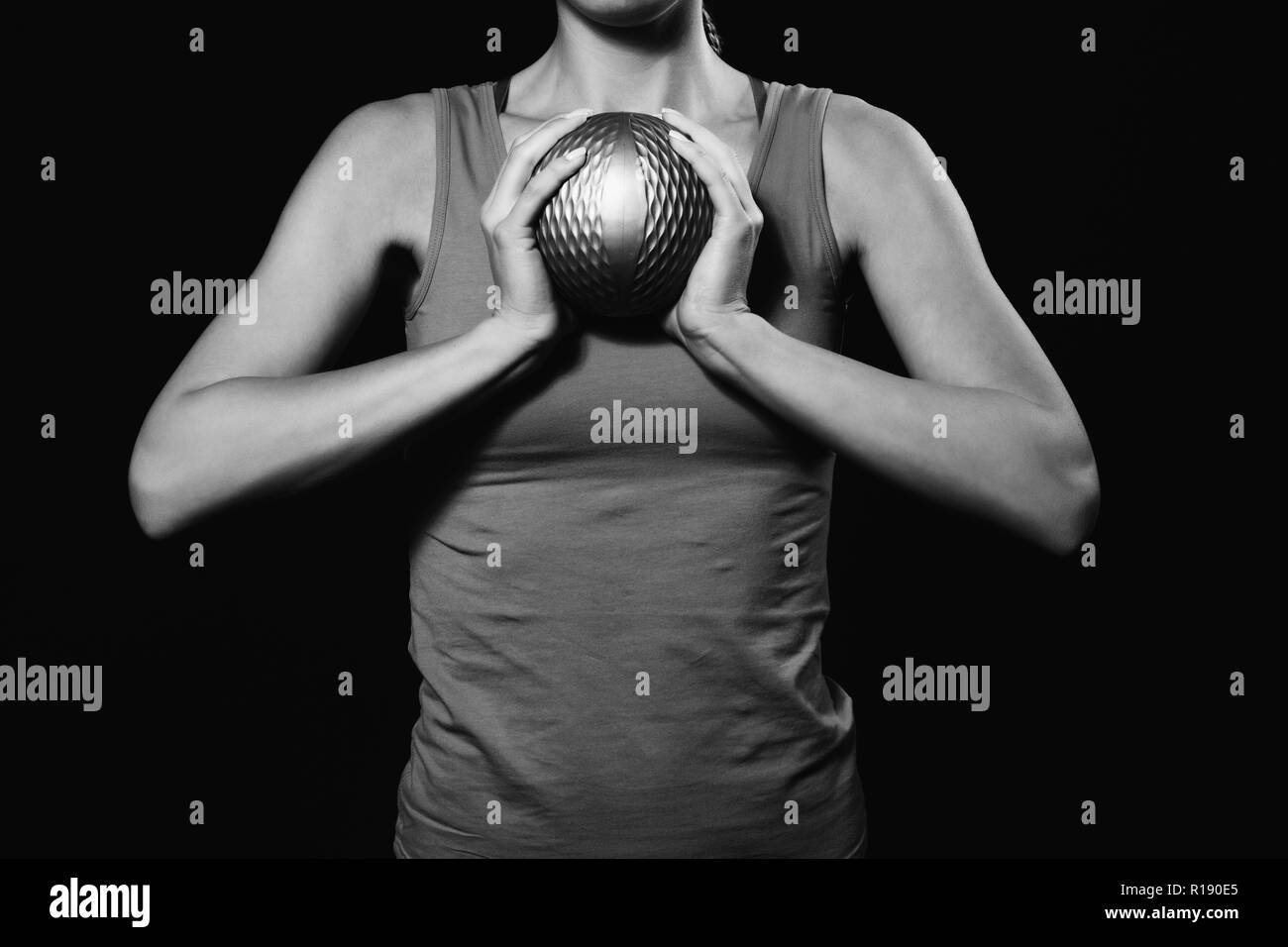 Woman is exercising with medicine ball. - Stock Image