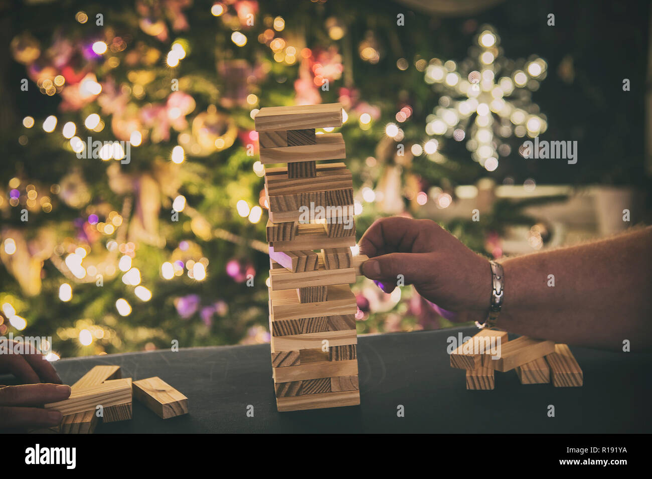 Christmas time - the family plays together party game Stock Photo