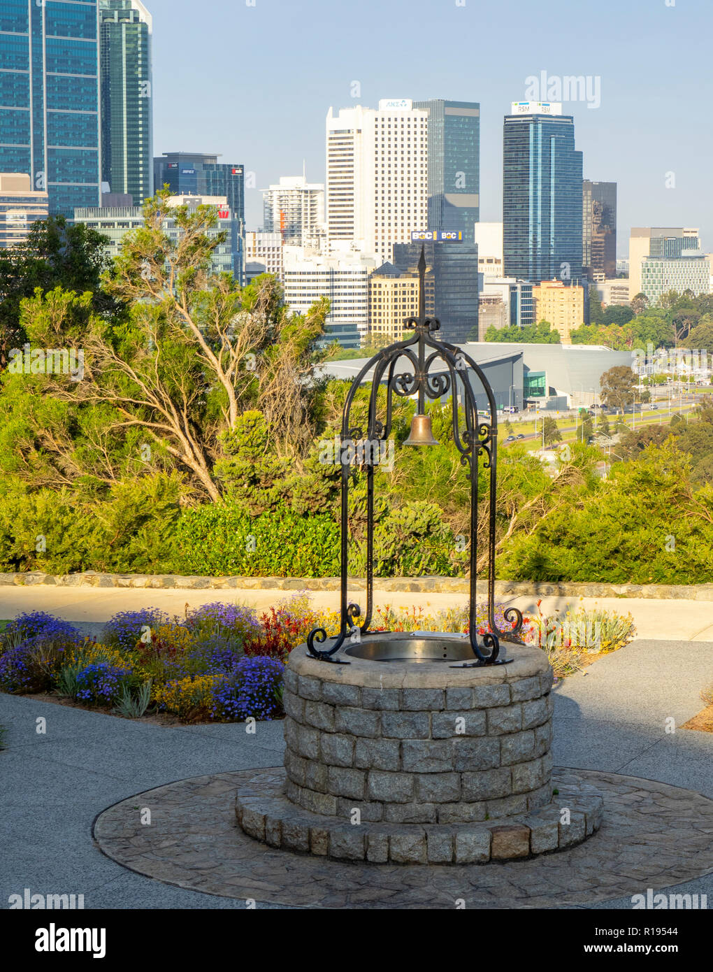 Rotary wishing well set in a garden of wild flowers Kings Park Perth Western Australia - Stock Image