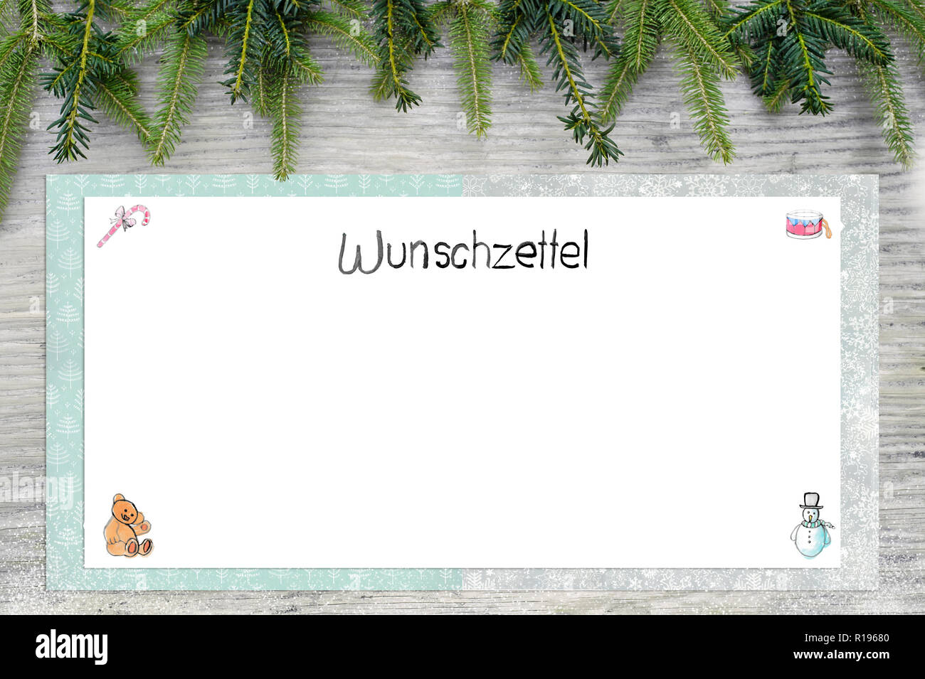Christmas illustrations. English german text wish list as handlettering. In the background is wood and fir green. Stock Photo