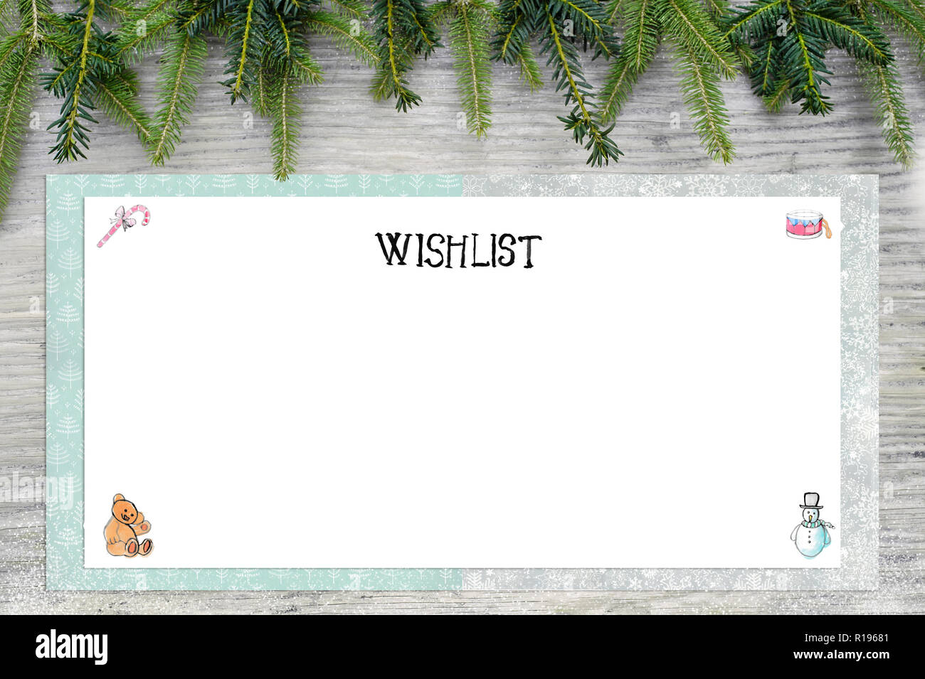 Christmas illustrations. English text wish list as handlettering. In the background is wood and fir green. Stock Photo